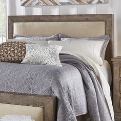 Features:  -Casual rustic styling.  -Mitered framed bed features upholstered bed with nailhead trim.  -Weathered gray finish.  -Shiny upholstery: No.  Finish: -Weathered Gray.  Distressed: -Yes.  Fram