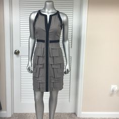BCBG Maxazria Dress Very Chic BCBG Maxazria Tan & Black Dress with partial open back and neck closure! Like New! Only Worn Once! I LOVE this dress!! If it doesn't sell at a good price, I will probably keep it! One of my Favorites! BCBGMaxAzria Dresses