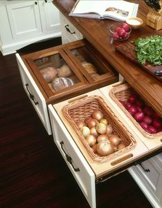 dry storage drawers beautifully organize pantry goods such as bread, garlic and potatoes.