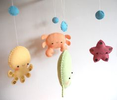 *** THIS LISTING IS FOR A PDF PATTERN ONLY! ***  Ive designed these four cute sea creatures as ornaments for a baby crib mobile, but they can easily become a garland, knob ornaments, window or door decorations, party favors, pocket plushies, brooches, gifts for newborns... anything you imagination suggests!  This listing is for a set of FOUR ornaments: octopus, whale, starfish and crab. Finished items measure from approx. 7cm / 2.7 (the starfish) to 15cm / 6(the whale) at their wide...