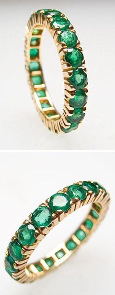 Estate Natural Emerald Eternity Style Band Ring Solid 18K Gold. This elegant estate natural emerald eternity style band is crafted of solid 18k yellow gold. The emerald stones show gentle abrasion and the ring is in overall very good condition. Via Era Gem.