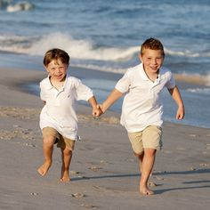 Brothers running on the beach - Photo by Deborah Kalas Photography
