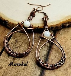 A perfect pair of earrings for the beach. Copper wire is woven and formed into a teardrop shape. Wires crossover at the top of the teardrop forming a small frame for the shell bead. Wire is oxidized and polished. White shell bead is wired at the top of the teardrop. Teardrop is about 1 7/8 #wirejewelry