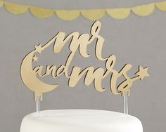 This cake topper features a moon and stars. It would look beautiful for a nighttime wedding or an under-the-stars themed event. | Under the Stars Cake Topper | 7 Beautiful and Unique Cake Toppers You'll Love