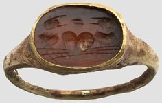 Golden ring with gem ,      Roman, 1st Century. AD Oval Carnelian with cut decoration