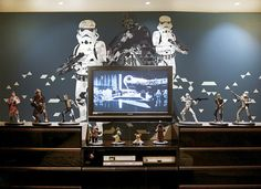These would look great in Tom's room http://www.etsy.com/listing/158950645/star-wars-wall-mural