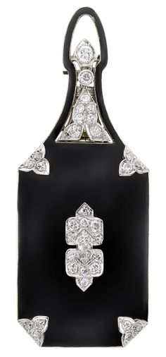 An Art Deco Platinum, White Gold, Black Enamel and Diamond Lorgnette, circa 1925. #ArtDeco #lorgnette