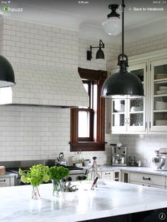 I love this white with the wood trim w… Bright Farmhouse Carrera Marble kitchen. I love this white with the wood trim w… - Marble Decor