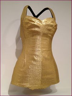 Gold Lastex lamé and cotton bathing suit by Margit Fellegi for Cole of California, American, 1950-51. Hollywood glamour was distilled, translated, and transmitted in swimsuits such as this glittering lamé example, which was probably made as a promotion for 'Million Dollar Mermaid,' starring cinema's aquatic icon Esther Williams.