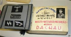 Germany Drawings From Dachau-Nazi patches and a cover page with a photo of Arnold Unger are seen in an album of drawings from the Dachau concentration camp by Polish artist Michal Porulski at the International Tracing Service at Bad Arolsen, Germany, Aug. 21, 2007. After her father's suicide in 1972, Shari Klages found the thick leather-bound album with 30 ink-and-watercolor drawings that convey the brutality of Dachau. (AP Photo/Arthur Max)