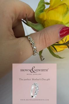 For the glamorous mum in your life, Brown & Newirth create lovingly handcrafted jewellery from earrings, pendants and bracelets to eternity engagement and wedding rings. This is the Kalei ring, handcrafted; hopscotch set round brilliant cut diamonds adorn 40% of this classic court band. Total carat weight 0.50ct #diamondring #mothersday #motherdaygifts