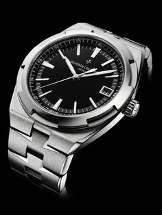 Overseas with a new black dial Luxury Watches, Rolex Watches, Cool Watches, Watches For Men, Vacheron Constantin, Hand Watch, Watch Companies, Black Rubber, Stainless Steel Bracelet