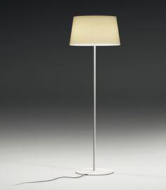 Warm is a floor lamp with an off-white screen mesh shade that is appealing, elegant and adaptable to any atmosphere. Designed by Ramos & Bassols, the body is finished in off-white matte lacquer. On/off switch on cord. Frosted acrylic top diffuser. DESIGNER:  Ramos & Bassols  MATERIALS:  Acrylic Diffuser  MEASUREMENTS:  Overall Height: 51.97 inch Shade Height: 9.45 inch Shade Dia: 16.54 inch Base Dia: 12.80 inch  HELPFUL NOTES:  On/off switch on cord 3 x Compact ...