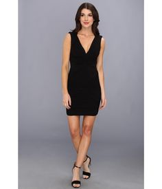 . Make the evening memorable in a sophisticated BCBGMAXAZRIA™ sleeveless dress.. Chic stretch jers...