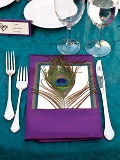Add a Feather Even small details can help set the mood and make your whole wedding feel more cohesive. This otherwise pretty-but-basic place setting gets just the right touch of elegance with an added peacock feather.
