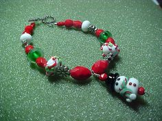 Snowman and candy cane lampwork beads with by LEFIALYNNCREATIONS, $50.00