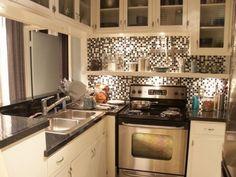 Mosaic tile splash back, cream units, black work top (set design 'Dexter's' apartment, Miami). #KitchenDesign