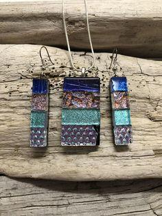 This pendant and earring set is handmade dichroic glass. The pendant and earrings are stunning and the pictures dont capture the real essence of the pendant. This pendant includes a silver chain in your choice of 16inch, 18, 20,22 or 24 inch Colour: blue, pink, gold and green Size of