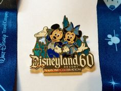 Free Disneyland 60th anniversary pin and lanyard with booking a travel package!