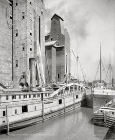 """Buffalo, N.Y., circa 1900. """"An old-timer at C.T.T. elevator."""" The Badger State at the Connecting Terminal grain elevator -- whose loading """"leg"""" was a huge structure on wheels -- on the City Ship Canal, next to the Marine Elevator."""