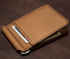 Handmade leather card wallet with a bar style money clip inside.