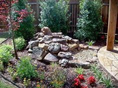 Maintenance Free Landscaping | Gravel Ideas for Backyard Landscaping with wooden pole