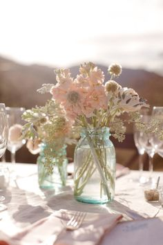 i like the light blue jars and the neutral flowers.