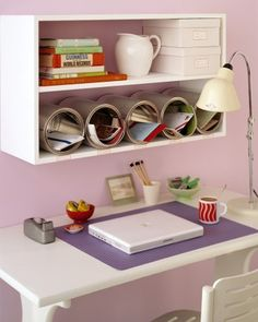 Don't let your desktop disappear under piles of paperwork. Inexpensive, unused cans can be purchased at paint stores; lined up on a shelf and anchored in place with Velcro, they become organizing cubbyholes with a modern flair.