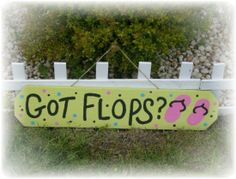 I need this sign!  Don't live near the beach but ya gotta have flops outside to play. Great for a wedding reception sign. ;-)