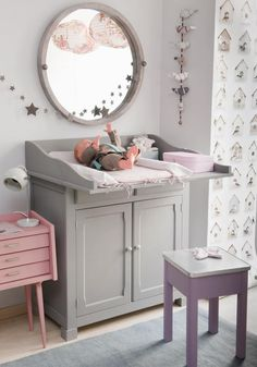 A changing table that allows you to change your baby in a vertical format !  so much easier and unique than the classic, traditional ideas.