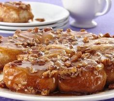 EASY CARAMEL ROLLS  3 T. corn syrup, divided  3 T. brown sugar, packed & divided  3 T. chopped pecans, divided  2 T. butter, cubed & divided  12-oz. tube refrig. biscuits  To each of 10 greased muffins cups, add one tsp. of syrup, brown sugar, & pecans. Top each with 1/2 tsp. butter & one biscuit. Bake at 400 for 8-10 min., until golden. Invert rolls onto a plate before serving. To see this & more yummy recipes, buy Gooseberry Patch's 101 Breakfast & Brunch Recipes at The Village Shoppes!