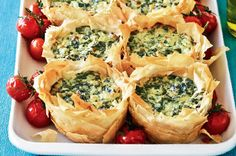 """To spinach and cheese we say """"yes please!"""", and if it also involves flaky filo, like these Greek-style pies, all the better! Try this recipe for an easy dinner or a spring picnic."""