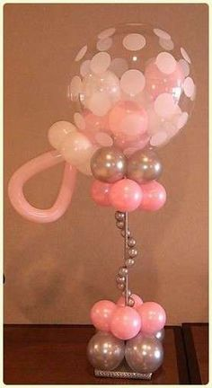 baby shower balloon rattles centerpieces  | CatchMyParty.com