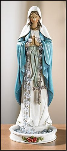 Display your rosary in the most attractive way using the Madonna Rosary Holder. Crafted from durable resin in the image of the Blessed Virgin, it features hands clasped in prayer that can securely fit any rosary while its sturdy base stands easily atop tables and altars.  ON BACKORDER:NOT AVAILABLE UNTIL MAY 2012