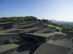 The folk art museum stands in the campus of China Academy of Arts in Hangzhou. The site was formerly a tea field that formed a hillside. Our point was to des...