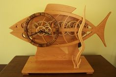 A spring driven wooden gear clock. The frame is made of American cherry and the dial is made of zebra wood. The gears are made of aircraft quality birch plywood from Finland. Wooden Gear Clock, Wooden Gears, Mechanical Gears, Planetary Gear, Handmade Clocks, Pocket Watch Antique, Scroll Saw, Wooden Walls, Wood Crafts
