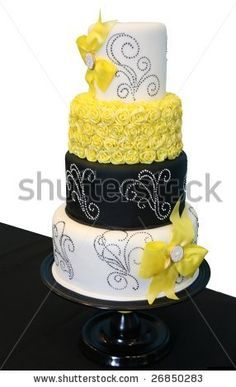Google Image Result for http://image.shutterstock.com/display_pic_with_logo/66451/66451,1237317964,5/stock-photo-black-and-white-patterned-wedding-cake-with-yellow-roses-26850283.jpg
