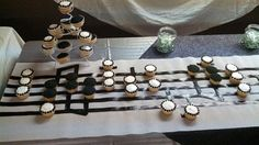 Used this for my spring recital.  Staff made out of one roll of white shelf liner and black duct tape.  Make some stems out of duct tape and place your cupcakes on as note heads.  Easy!