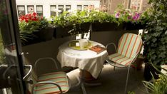 Cozy Ideas To Design Your Balcony - Use plants and flowers if you want to feel like you're in a secret garden