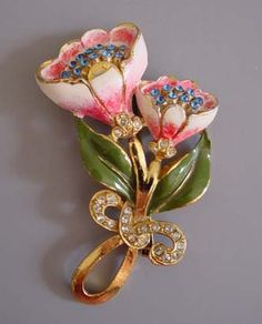 CORO pink and white enameled floral brooch with blue and clear rhinestones