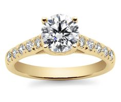 Ten round cut diamonds are prong set in this yellow gold diamond engagement ring setting, accenting your choice of center diamond. Proudly made in the USA. Retail Price: $2,125, Our Price: $850