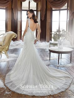 Sophia Tolli - Y21504 – Ricki - Lace wedding dress with corset back, fit and flare gown with draped lace, scooped neckline with slight cap sleeves and back straps with hand-beaded crystal lace appliqués and matching lace appliqués on the hip,back corset and chapel length train.Sizes: 0 – 28Colors: Ivory, White