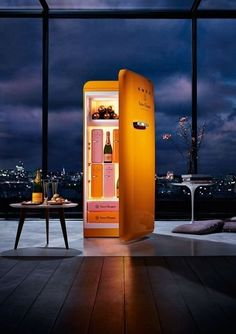 Fancy - Veuve Clicquot Fridge by Smeg (why would you want this in silver?)
