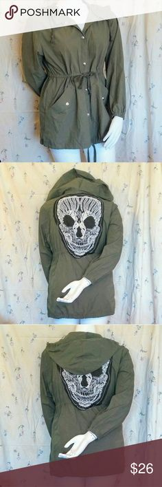 Skull Back Anorak Jacket Cargo Punk Hot Topic Coat Anorak jacket by Zanzea from Urban Outfitters.  Olive green with silver hardware--full snap button up front.  Elasticized waist, bottom hem, & hood, all with adjustable drawstrings.  2 front pockets, one on either side.  White lace skull & black mesh applique on the back!  Great pre-owned condition!  Size large, modeled on my size 12 mannequin. Urban Outfitters Jackets & Coats Utility Jackets