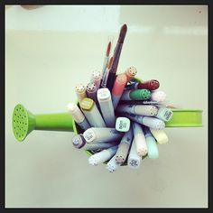 Copics in a mini watering can! Cute idea for a handful of supplies :)