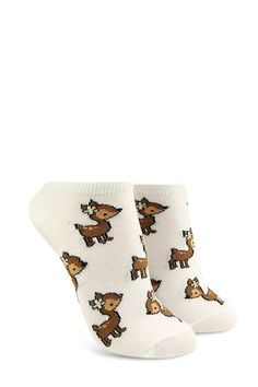 A pair of knit ankle socks featuring an allover baby deer print with a flower in its hair and ribbed trim.