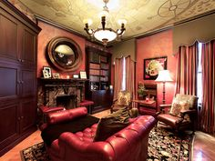 Advertisement  Rich Red    This traditional man's library is filled with rich leather and wood furniture. The antique map ceiling draws the eye upward, while the red Venetian plaster walls add texture.