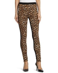 "Natural Leopard Ponte Leggings Black fabric in back  Leopard-print Ponte leggings? Yes, please. The safari-style spots bring an exotic edge to the knit silhouette. Modern, effortless, and made for you. Chico's Ponte ™ knit fabric has a flattering, forgiving, cling-free drape. Our leggings sit just below the waist, for a modern fit with maximum comfort. Pull-on styling with an elastic waistband. 28"" inseam regular. 26"" inseam petite. 87% rayon, 10% nylon, 3% spandex. Machine wash. Imported."