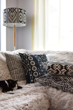 Living room corner with Lamptekture lamp and Halfdrop pillows Room Corner, Animal Print Rug, Beautiful Homes, Throw Pillows, Living Room, Bed, Interior, House, Home Decor