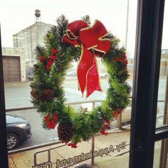 #HolidayTip - Hang a wreath on a glass door like we did at #SWISCO using one of our Giant Suction Cup Holders - Christmas Decorations